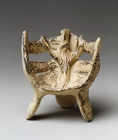 Terracotta female figure in three-legged chair Period: Late Helladic IIIB Date: 13th century B.C. Culture: Helladic, Mycenaean