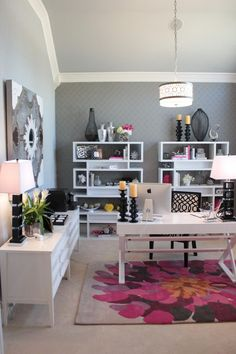 This feminine office showcases unique office lighting and out of the ordinary color pops that make this a home office dream.