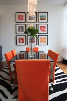 love intense pops of color in the dining room. the zebra patterned rug is really great too!