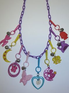 charms of the 1980s | 1980s Plastic Charm Necklace Jewelry 80s Purple Chain 9 Charms Vintage ...