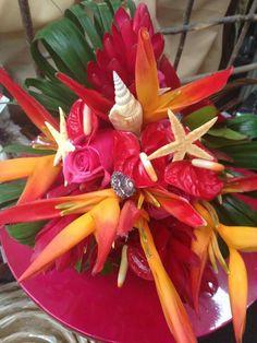 Bird of paradise, roses, haliconia,anthrium, sea shells