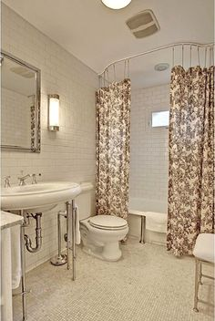 Up your shower curtain game by using two curtain panels and hang them from the ceiling. It works well in this bungalow bathroom, but will translate well to many styles. Craftsman Interior, Craftsman Style, Bungalow Bathroom, Cottage Bath, Tiny Bath, Upstairs Bathrooms, Master Bathroom, Bungalow Homes, Modern Cottage