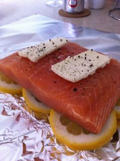 Salmon in Foil -- sliced lemon, salmon, butter, salt and pepper. Bake at 325-350 for about 25 minutes.