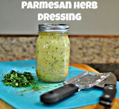 Parmesan,garlic, dijon mustard, cilantro, basil, rosemary, spicy oregano and lemon thyme infuse extra virgin olive oil for a simple, tasty and way-better-for-you homemade dressing recipe that is a winner every time over store bought dressings.