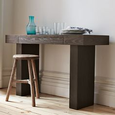 Strong, simple and eco savvy. A west elm green product, this minimalist multi-functional console table can also be used as a space-saving desk. (Its front conceals a hidden drawer.) The monolithic form is made from durable wood that's been certified as sustainably harvested by the nonprofit Forest Stewardship Council (FSC) then finished with recycled-aluminum hardware and water-based stain and glues. A pure and perfectly proportioned addition to any room.