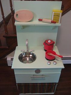 DIY play kitchen from a nightstand. I'm going to look for an extra nightstand at thrift stores!