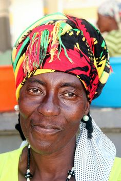 A colorful head gear for this woman of Santiago, Cape Verde, Africa.