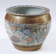 """Early 20th century Satsuma fishbowl, with parcel gilt and polychorme decoration, the geometric and cloud-form bands surrounding a landscape including ducks and cherry blossoms, the interior with koi fish and plant life, the base marked, 18""""h x 20.5"""" diameter."""