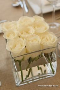 Pretty, modern, and simple white centerpieces