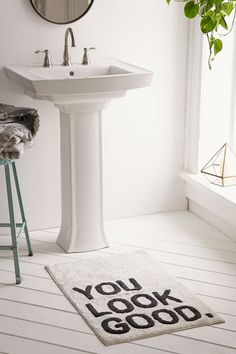 A cushiony bath mat that'll pay you a compliment as you step up to the sink. I sure need that most mornings!