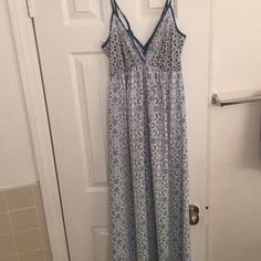 Blue mixed print maxi dress All over printed maxi with a tie back. Dresses Maxi