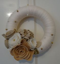 Yarn wrapped wreath.  Like the gold bead accents.                                                                                                                                                                                 More