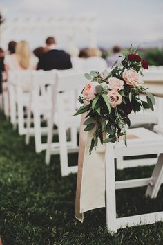 Ceremony aisle: Two bigger floral arrangements on two end chairs, none on the rest; use same arrangements on sweetheart table chairs