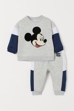 Set with a soft long-sleeved sweatshirt and sweatpant joggers. Sweatshirt with snap fastener on one shoulder and ribbing at neckline cuffs and hem. Joggers with elasticized drawstring waistband and ribbed hems. Boys Summer Outfits, Baby Boy Outfits, Kids Outfits, Toddler Boy Fashion, Kids Fashion, Toddler Boys, Toddler Chores, Boys Tracksuits, Unisex Baby Names