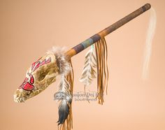 This is a rustic Native American Indian medicine dance stick. We received this dance stick during a pow wow. The spirit stick features a leather wrapped handle with hand beading, fringed drape and pra