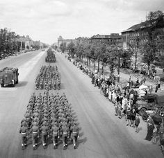 JUL  23 1945 Churchill entertains Truman and Stalin in Berlin - See more at: http://ww2today.com/British Victory Parade in Berlin: British troops march down the Charlottenburg Chaussee, Berlin.
