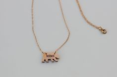 """A teeny tiny bronze bear with the word Mama stamped on it - the perfect sentimental piece for all those fierce Mama Bears out there! 14k gold filled chain hangs 18"""" and the bear charm is .7"""" �can customize the length of chain at no extra charge just leave your desired length in the note to seller at checkout!This is a pre-sale item - please allow 4-5 weeks for delivery. The bear is made of bronze and will naturally patina over time."""