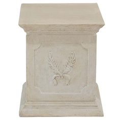 Laurel Leaf Plinth. This weathered, faux French limestone work of garden art has the style worthy of an old French estate. Our plinth, embellished with laurel accents, is cast in quality designer resin to highlight its foliate details. #French #plinth #gardenart