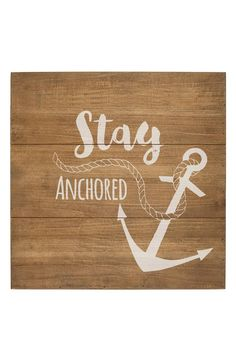 """Crafted from rich fir wood and stamped with a cool nautical design and """"Stay Anchored"""" text, this beautifully finished sign adds a rustic seaside vibe to any room in your home."""