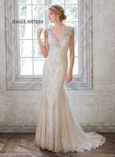This romantic wedding dress, Elison by Maggie Sottero, combines our favorite things... Sequins, lace, and sparkling Swarovski crystals.