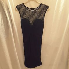 Guess black dress Guess, size L, black, lace on top of bodice, cinched in middle of the back and on sides, lace has small (not very noticeable) hole in the back (as seen in photos), material is very soft to the touch, 94% viscose 6% spandex night out dress. Guess Dresses