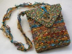 woven by fiber artist Nancy Faris - I like the use of fun textured yarns, and subtle color constrasts.