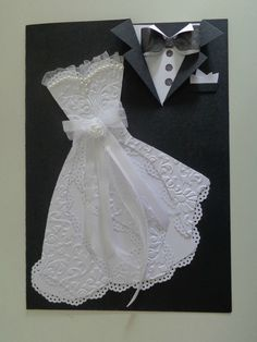 Wedding dress & Tux,  The bow tie anchors the white card stock inside the black envelope.