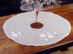 This felt tree skirt features snowflake appliques and snowball trim. From the experts at HGTV.com.