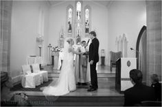 Saying their vows.. Amelia Phillips and partner on their wedding day. Amelia's wedding dress by Skarr Bridal, North Sydney.