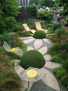 Diarmuid Gavin's Westland Show Garden by Karolanna, via Flickr.  Love the whimsical treatment of the landscaping here and the use of the brick pavers to form the flowers.