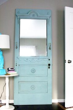 old door repurposed as a mirror or an entry piece -- just spray the back of glass with Looking Glass spray paint to create a vintage-looking mirror and add a shelf with two brackets and a 1x6