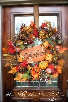 This wreath is pretty large and made from garland and picks. The last two years I had our initial hanging in the middle but I wanted to change things up a bit this year so I added the pumpkin Autumn sign and some more picks.