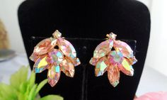"""Valentines Day Sale! JULIANA AB Rhinestone Pretty in Pink Tulip Shaped Earrings Set in Goldtone with Clip-On Backs. Very light scratches on bezel. Priced at $23.00 and measure 1"""" in size. Gorgeous! See more photos at our online store at www.CCCsVintageJewelry.com. These are verified Juliana earrings. To learn more about the brand Juliana please visit our vintage jewelry blog at www.CCCsVintageJewelryBlog.com Free Shipping via USPS First Class Mail. Your new earrings will be placed in a light…"""
