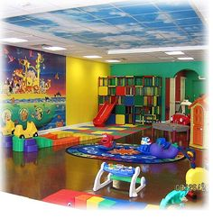 Therapy room. Love the roller coaster toy and the climbing gym/slide