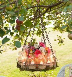 Light up your garden with a beautiful chandelier of Mason jars, flowers and a recycled base.
