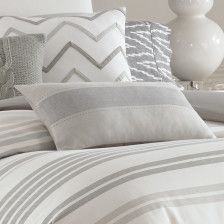 Blocked with a soft grey stripe at the center, this rectangular throw pillow is a perfect accent.