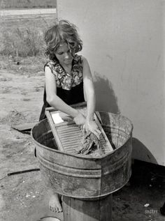 """February 1939. """"Twelve-year-old girl who keeps house in a trailer for her three brothers who are migrant workers, near Harlingen, Texas."""" 35mm nitrate negative by Russell Lee for the Farm Security Administration."""