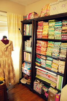 I would love to have an area this neat and tidy for all of my fabric and craft supplies