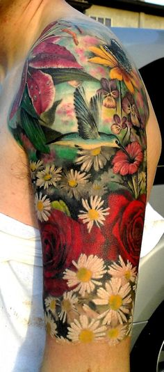 Love that he has the butterfly and hummingbird in this.  Vivid, great colors.  Lovely tattoo.