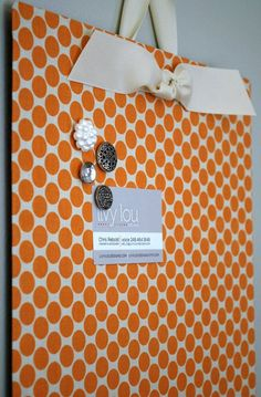 Cover a flat cookie sheet ($1 store!) with fabric and get an instant magnet board.  LOVE this (and probably already pinned it)