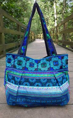 An Ethnic Boho Style Tote Bag Handmade with Traditional Hmong Fabric. This bag exhibits brilliant colours with bold embroidered patterns of exotic