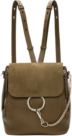 Grained calfskin and suede backpack in 'woody' khaki. Detachable carry handle with lanyard clasp fastening. Twin detachable and adjustable shoulder straps with lanyard clasp fastening. Logo embossed at face. Lanyard clasp on curb chain attaches to hoop hardware at face. Zippered expansion panels at face. Foldover flap with magnetic press-stud fastening. Logo patch, zippered pocket, and patch pocket at bag interior. Twill lining in beige. Silver and pale gold-tone hardware. Tonal stitc...