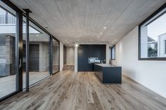 Image 3 of 35 from gallery of EFH Riedholz / Tormen Architekten AG. Photograph by Mark Drotsky Architekturfotografie Kitchen Dining, Dining Rooms, Interior Architecture, Hardwood Floors, Villa, Outdoor Decor, Furniture, Design, Home Decor