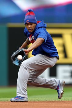 Addison Russell #27 of the Chicago Cubs warms up during Media Day workouts for the 2016 World Series against the Cleveland Indians at Progressive Field on October 24, 2016 in Cleveland, Ohio.
