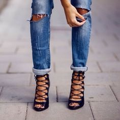 distressed boyfriend jeans + lace up black heels