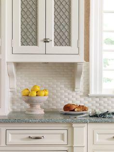 Encore Ceramics | 1 x 3 Crescendo Herringbone mosaic in Bianca matte adds just the right amount of texture to this classic kitchen