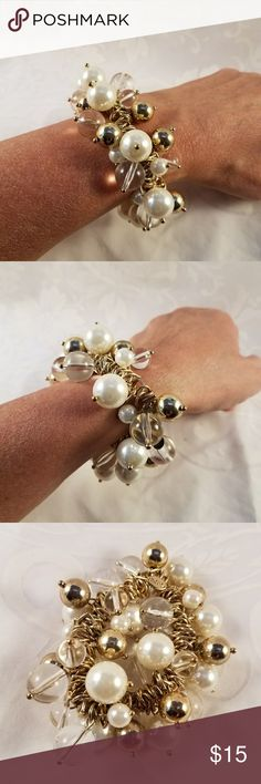 Chico's Elastic Bauble Bracelet Fun, stretchy bracelet in goldtone base, covered with wintery, shiny baubles of white, clear, and gold. Great for an elegant Holiday party! Great preowned condition. Chico's Jewelry Bracelets
