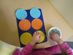 fine motor practice-marble, tongs, and small bathroom suction cups