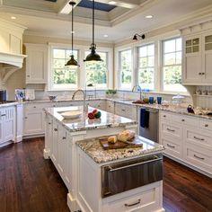 White cabinets with cream beadboard backsplash and medium color countertops