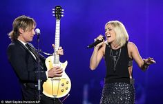 Rocking out: Keith and Carrie belted out Stop Draggin' My Heart Around